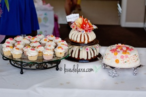 "Two tier ""Cute as a Bundtin"" cake & custom cupcakes & button cake"